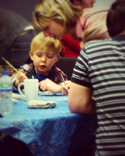 Child at the awesome Paint your own Fairy Door workshop run by artist James Waterfield Photography By Iain Turrell