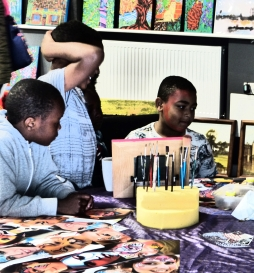 Children at the awesome face painting stall run by artist Philippa Newman Photography By Iain Turrell