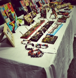 Stall selling hand made items with a comic book and retro theme by Emily Murphy Photography By Iain Turrell